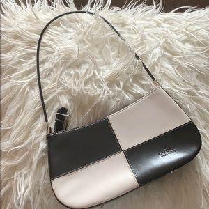 authentic Gucci black and white handbag.